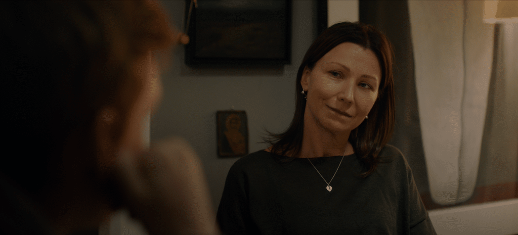 Maggie (played by Anita Hegh) talks to her son, Ben (Benson Jack Anthony), in HIGH LIFE.